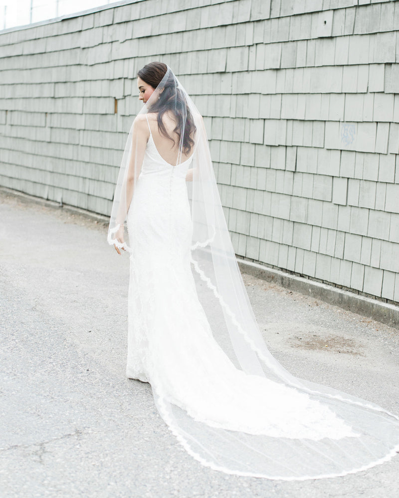 Model wearing Senna Lace Chapel bridal Veil