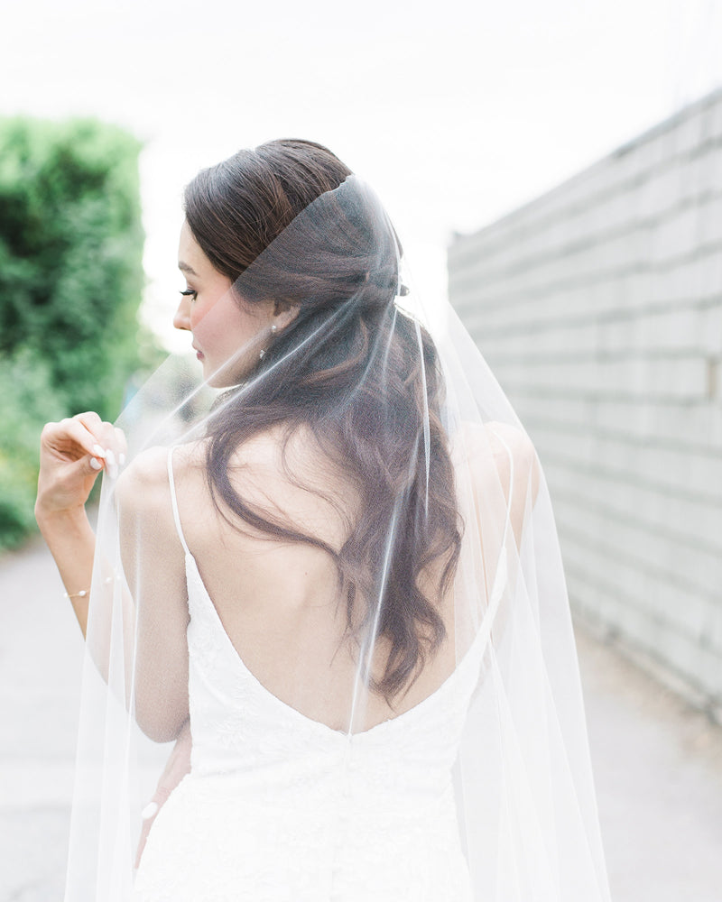 Model wearing Senna Long Lace bridal Veil