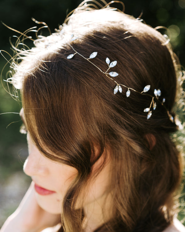 Model wearing Sparkling swarovski crystal bridal hair vine in gold
