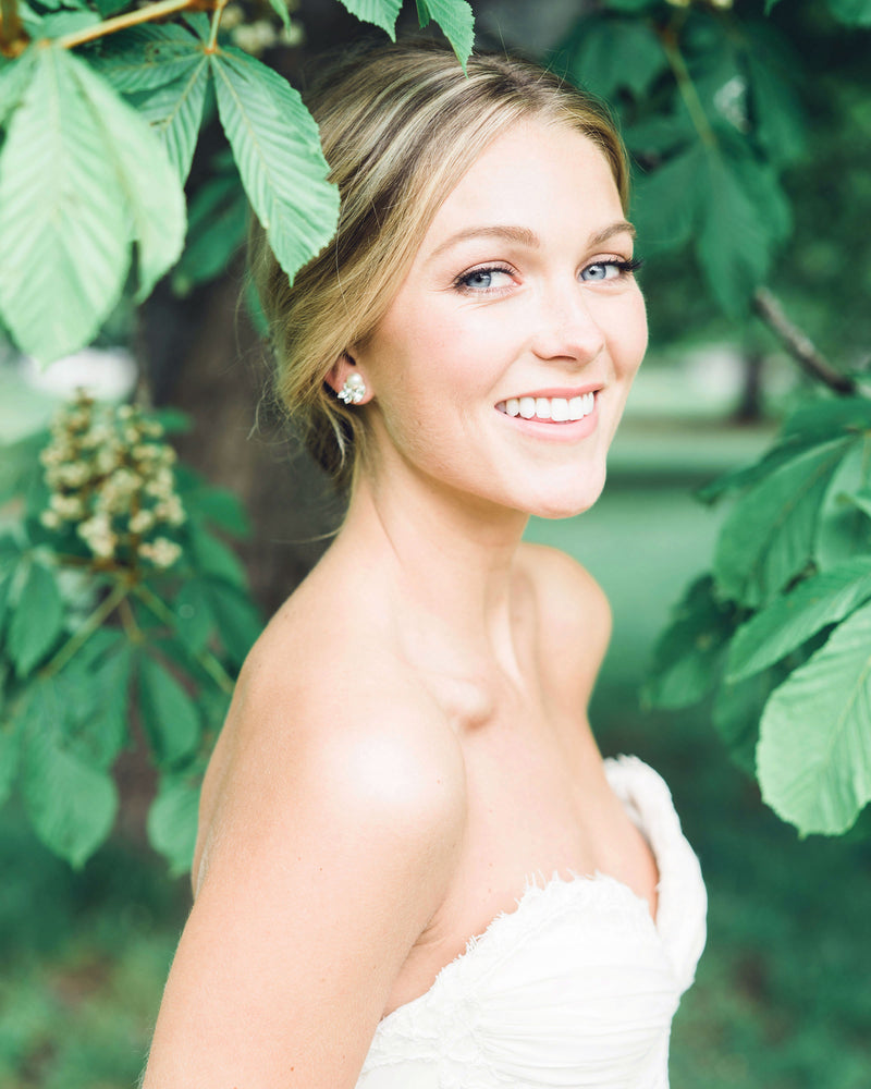 model wearing starlight swarovski crystal freshwater pearl bridal stud earrings
