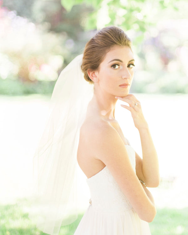 Model wearing Symphony plain short blusher wedding veil