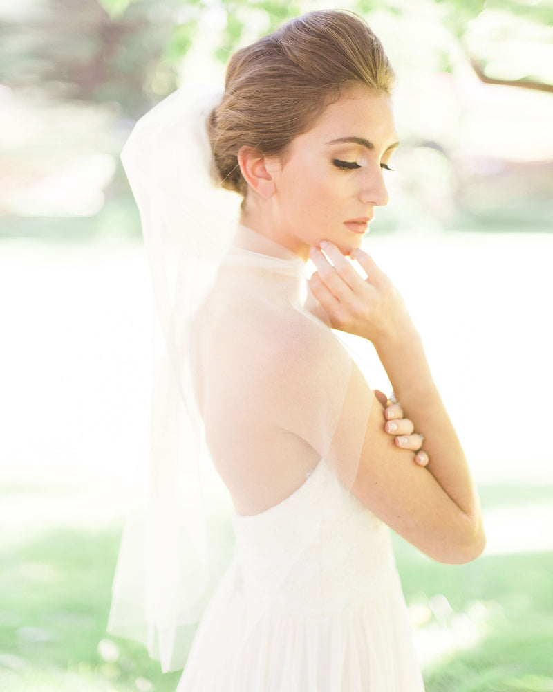 Model wearing Symphony short plain blusher bridal veil