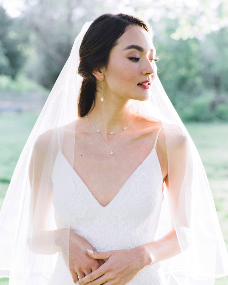 Model wearing Teardop pearl Long drop bridal earrings