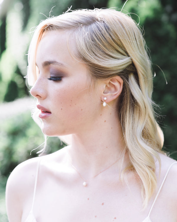Model wearing Teardrop Pearl Petite drop Earrings