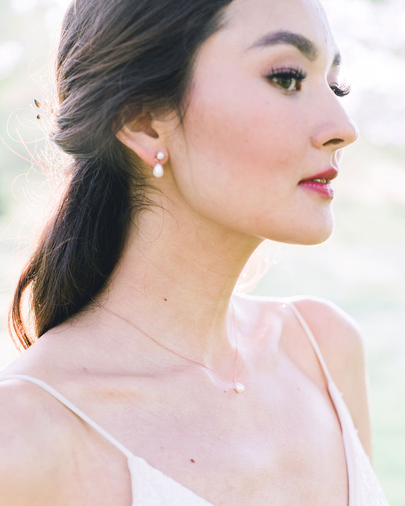 Model wearing Teardrop Pearl small drop Earrings bridal jewelry