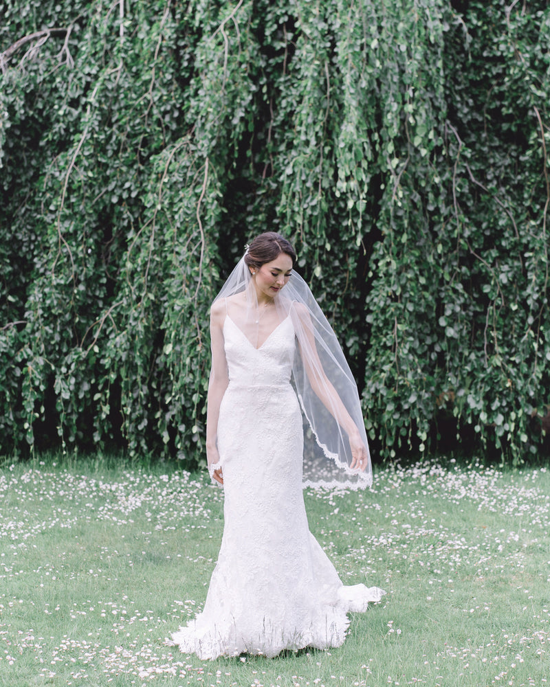 model wearing wisteria short lace wedding veil