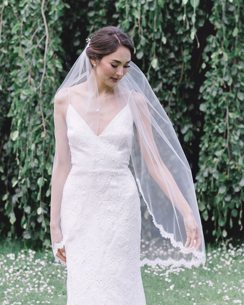 model wearing wisteria fingertip lace wedding veil