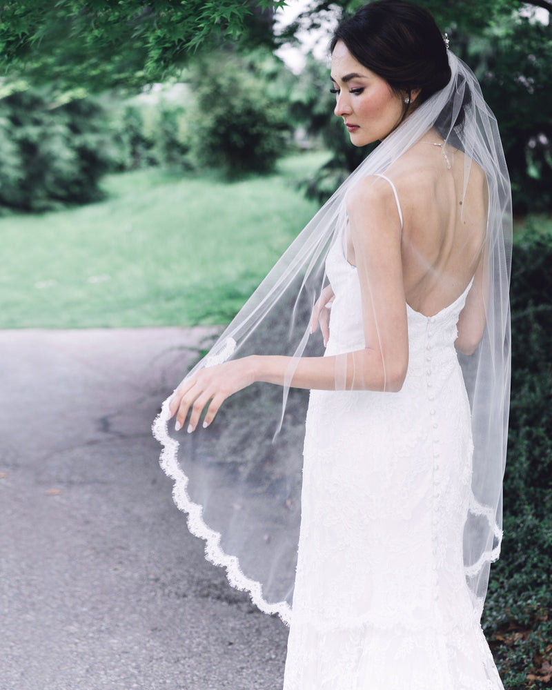 model wearing wisteria fingertip lace veil