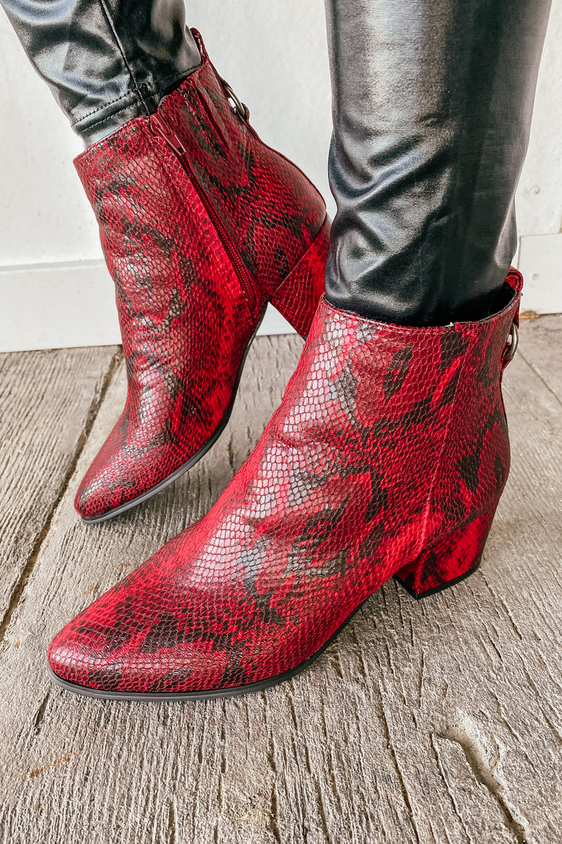 The Snakeskin Booties in Cranberry