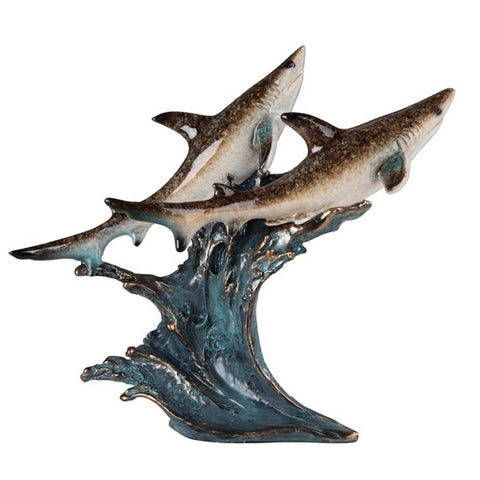 Sharks on wave figurine