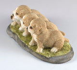 Four Puppies Dog Figurine