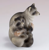 Raccoons On Branch Figurine