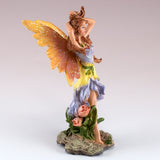 Small Purple Fairy Holding Hair Up Figurine 2
