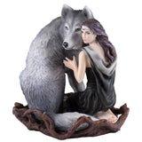 Woman Sitting With Wolf Figurine 1