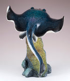 Large Stingray Swimming Over Rock Figurine
