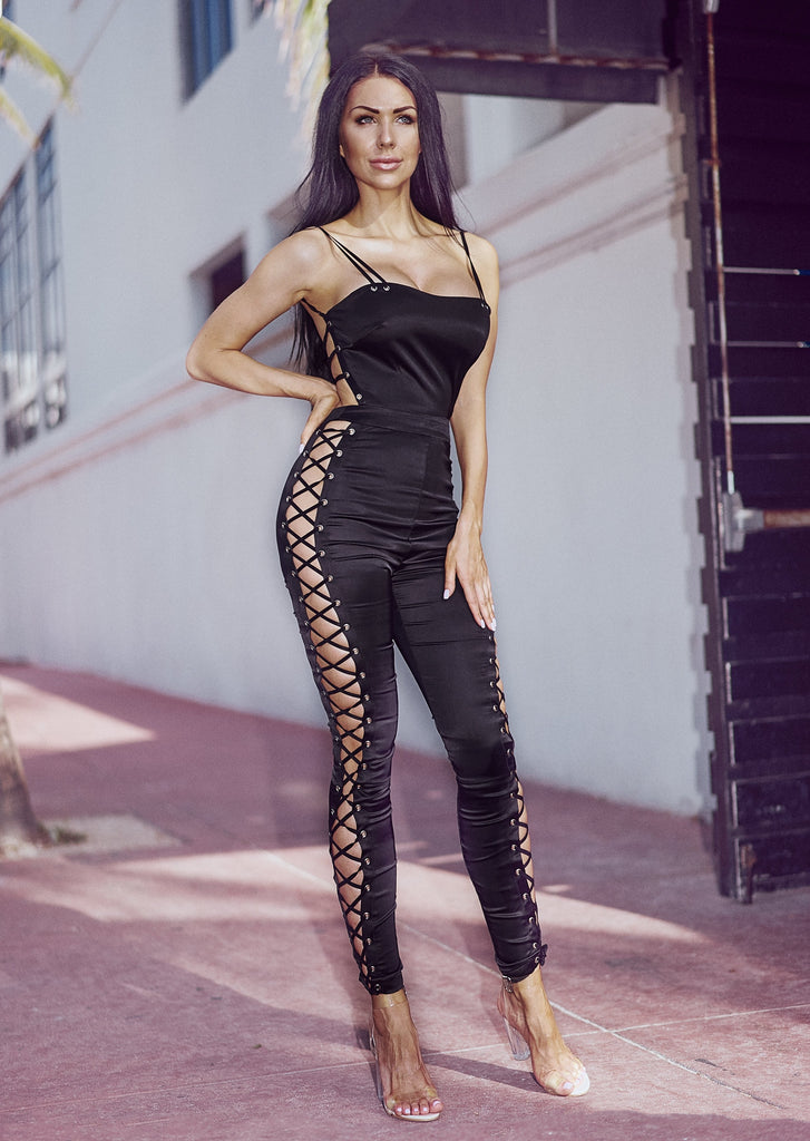 Jumpsuit with lace up details on the sides and open back