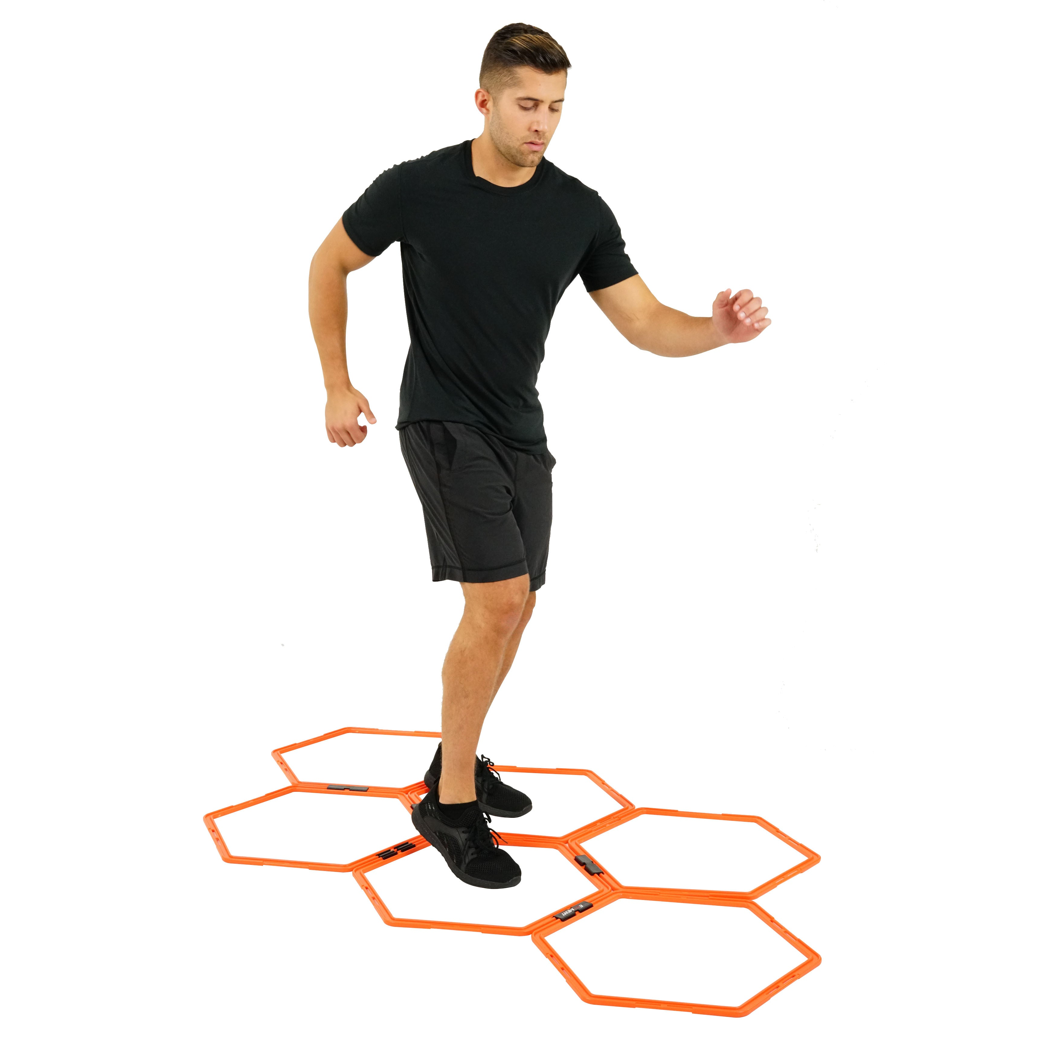 man exercising on hex rings