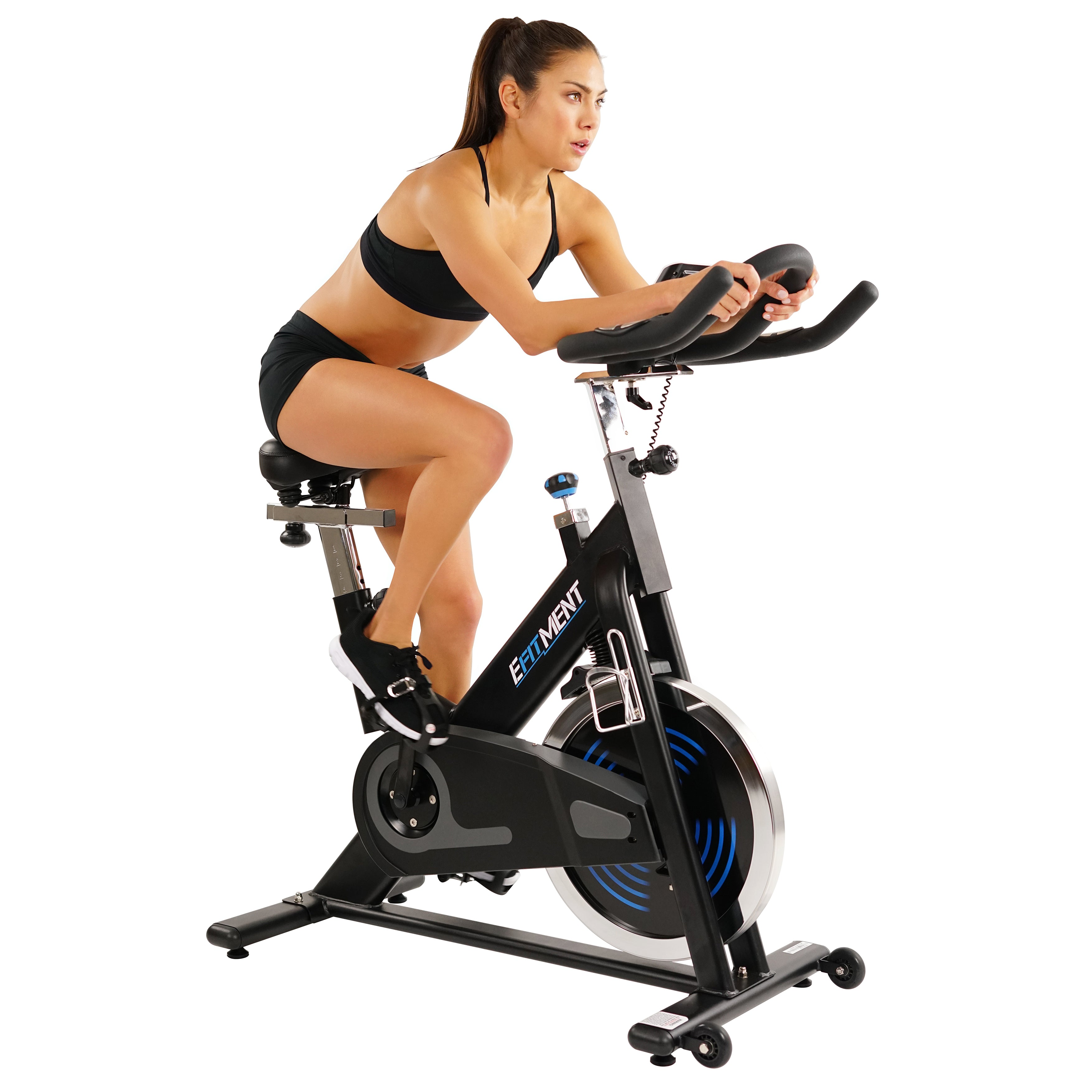woman riding indoor cycle bike