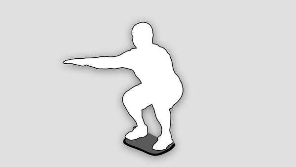 silhouette of man doing squat on stability board