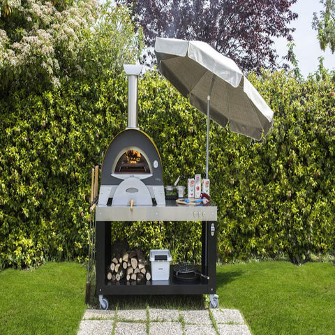 Image of Alfa Ciao M Countertop Wood Fired Pizza Oven in Backyard on Cart