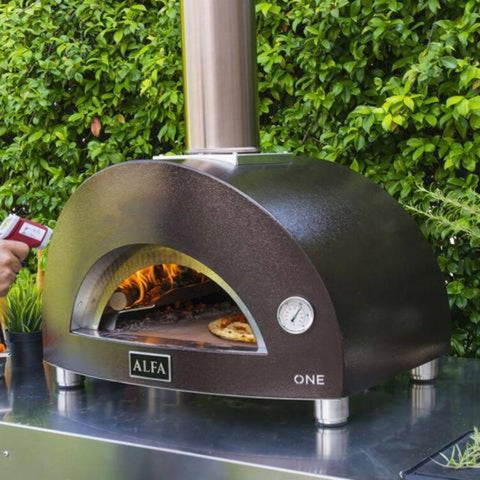 Image of Alfa ONE Countertop Wood Fired Pizza Oven On Cart Using Temperature Heat Gun