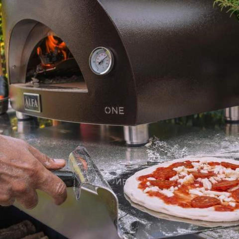 Image of Alfa ONE Countertop Wood Fired Pizza Oven Cooking Pizza