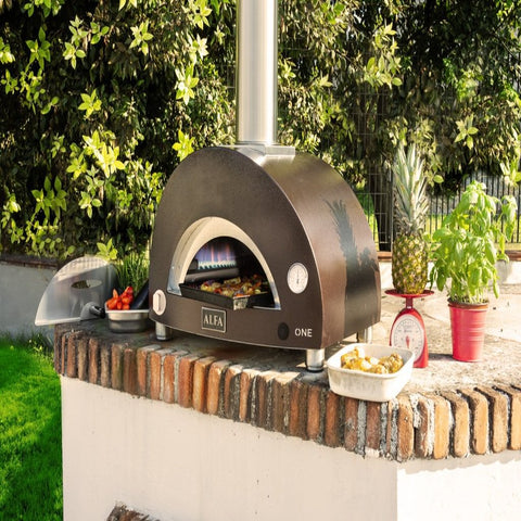 Alfa ONE Countertop Gas Pizza Oven Cooking Outside on the Back Patio