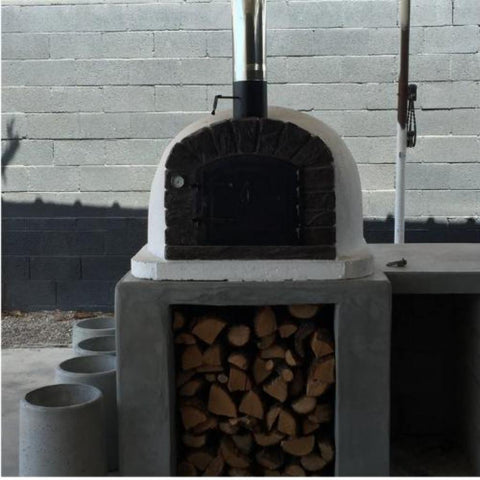 Authentic Pizza Ovens Famosi Countertop Wood Fired Pizza Oven on Concrete Outdoor Kitchen Counter