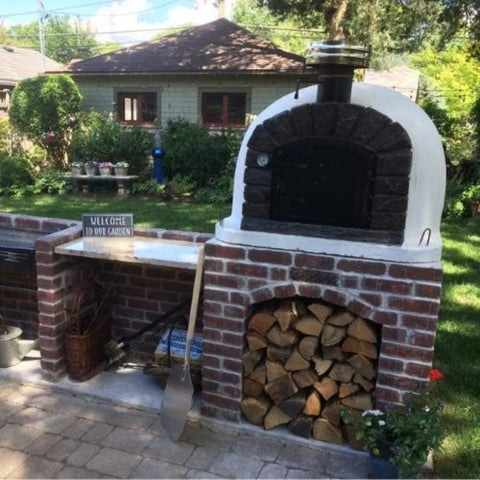 Authentic Pizza Ovens Famosi Countertop Wood Fired Pizza Oven in Back Yard on Custom Built Brick Base