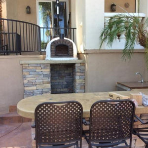 Authentic Pizza Ovens Famosi Countertop Wood Fired Pizza Oven on Custom Built Stone Back Patio Base