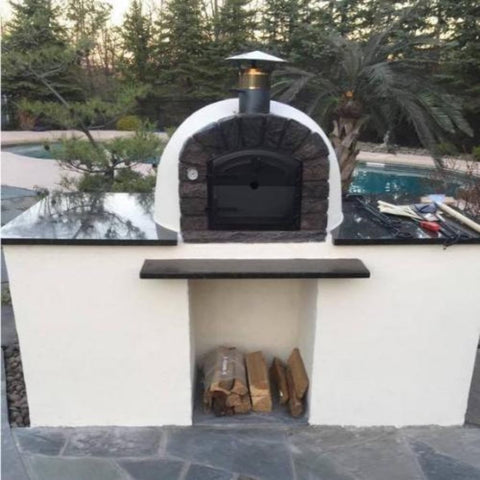 Authentic Pizza Ovens Famosi Countertop Wood Fired Pizza Oven on White Customer Base with Black Stone Counter