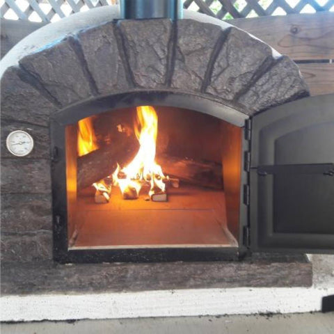 Authentic Pizza Ovens Famosi Countertop Wood Fired Pizza Oven with Door Open and Fire Burning