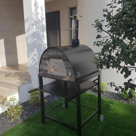 Authentic Pizza Ovens Maximus Arena Countertop Wood Fired Pizza Oven in Black on Black Stand in Backyard