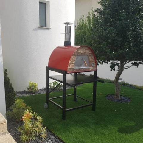 Authentic Pizza Ovens Maximus Arena Countertop Wood Fired Pizza Oven in Red on Black Stand in Backyard