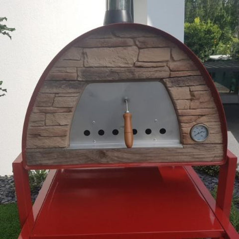 Authentic Pizza Ovens Maximus Arena Countertop Wood Fired Pizza Oven in Red Close Up View of Stone Facade Face Sitting on Red Stand