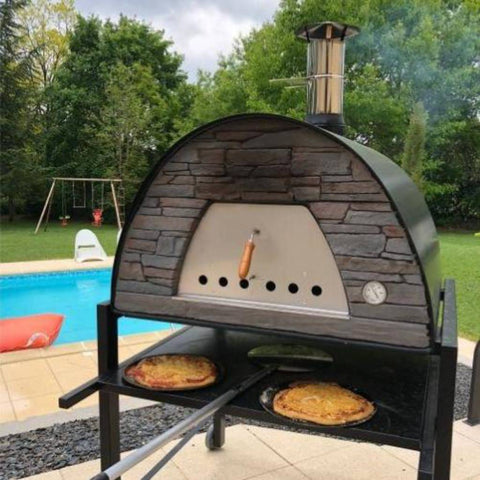 Authentic Pizza Ovens Maximus Prime Countertop Wood Fired Pizza Oven in Black on Stand Cooking Pizzas in Backyard with Pool