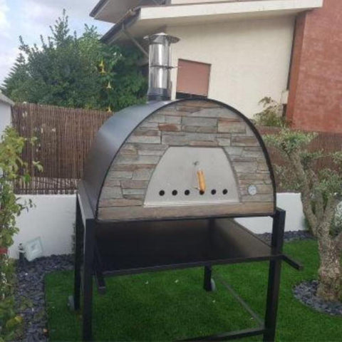Authentic Pizza Ovens Maximus Prime Countertop Wood Fired Pizza Oven in Black on Black Stand in Outdoor Yard