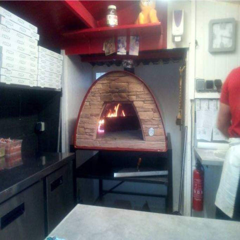 Authentic Pizza Ovens Maximus Prime Countertop Wood Fired Pizza Oven in Red in Commercial Kitchen with Fire Burning Inside Oven