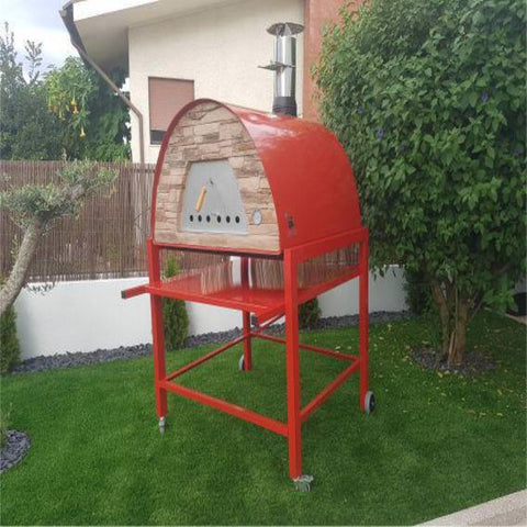 Authentic Pizza Ovens Maximus Prime Countertop Wood Fired Pizza Oven in Red on Red Stand in Backyard