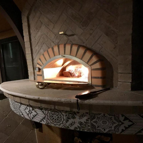 Image of Authentic Pizza Ovens Pizzaioli Countertop Wood Fired Pizza Oven Built In to Custom Outdoor Light Stone Kitchen