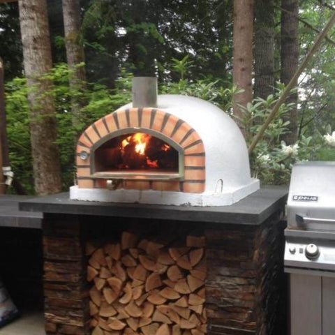 Image of Authentic Pizza Ovens Pizzaioli Countertop Wood Fired Pizza Oven in Backyard on Custom Built Stone Counter
