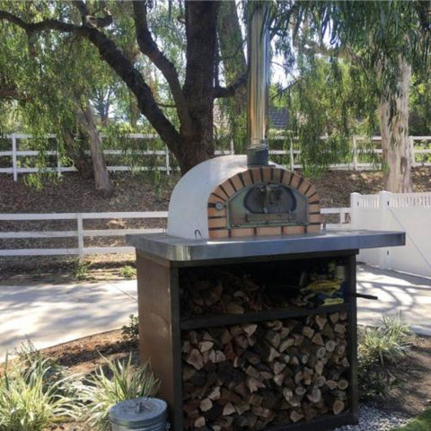 Authentic Pizza Ovens Pizzaioli Countertop Wood Fired Pizza Oven on Custom Concrete Base in Backyard in Summer
