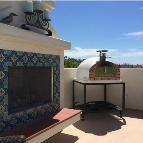 Image of Authentic Pizza Ovens Pizzaioli Countertop Wood Fired Pizza Oven on Black Stand on Back Patio