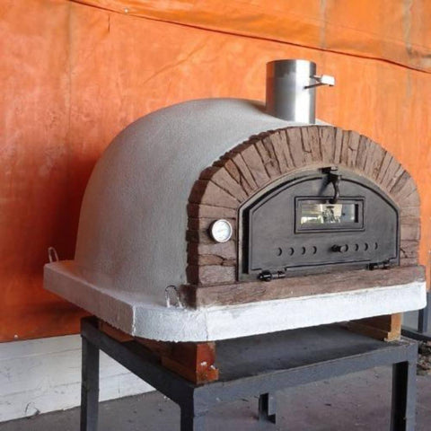 Image of Authentic Pizza Ovens Premium Buena Ventura Red Brick Countertop Wood Fired Pizza Oven on Pizza Oven Stand Outside