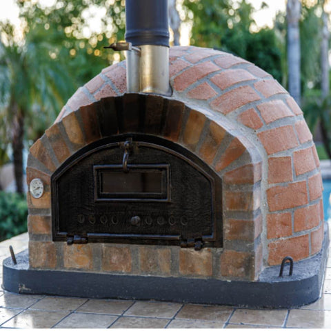 Authentic Pizza Ovens Premium Pizzaioli Rustic Finish Countertop Wood Fired Pizza Oven on Outdoor Patio in Summer