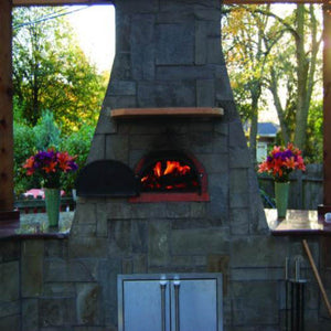 Chicago Brick Oven CBO 500 Wood Fired Pizza Oven Kit Custom Outdoor Kitchen with Dark Stone in Backyard in Summer