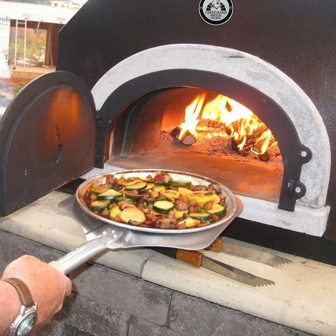 Chicago Brick Oven CBO 750 Countertop Wood Fired Pizza Oven Cooking Vegetables with Fire Burning Inside Oven