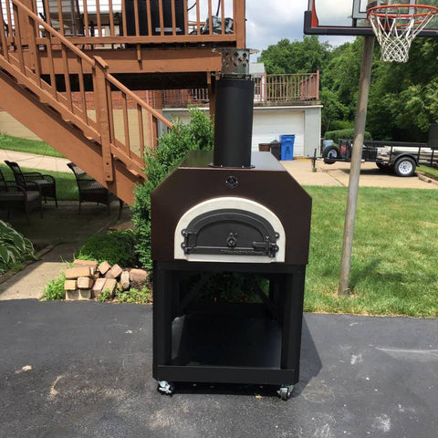 Image of Chicago Brick Oven Mobile CBO 750 Freestanding Wood Fired Pizza Oven in Copper Vein in a House Backyard in the Summer