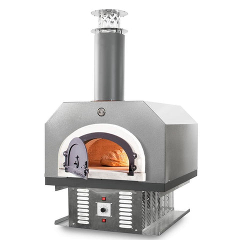 Chicago Brick Oven CBO 750 Hybrid Countertop Gas and Wood Fired Pizza Oven in Silver Vein with Door Open Cooking Bread