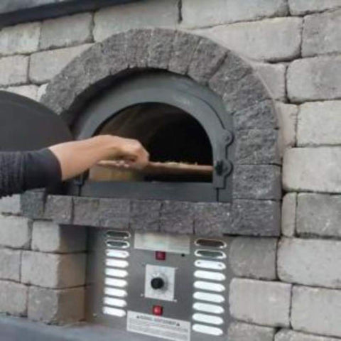 Chicago Brick Oven CBO 750 Hybrid Gas and Wood Fired Pizza Oven DIY Kit Custom Stone Back Patio Home Installation with Door Open and Cooking Pizza